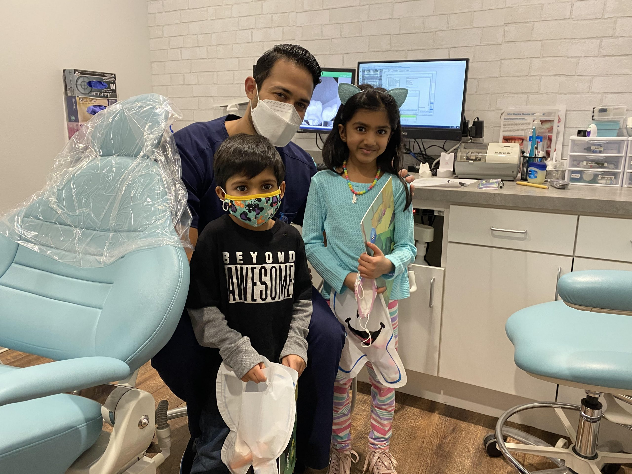 Family with Dr. Bhaumik after dental exam at Stonebrook Pediatric Dentistry